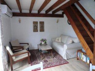 Woonkamer Gîte ' Rose' De gezellige woonkamer van gîte ' Rose'