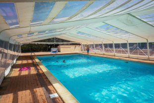 Swimming pool area <br>2 swimming pools, one is covered.<br>All are heated. <br>A outdoor baby pool is also heated.