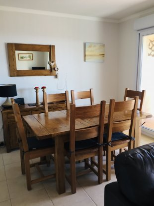 The dining area with solid oak dining table and chairs seating six.