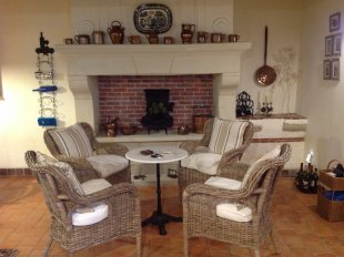 cosy kitchen seating area and decorative fireplace